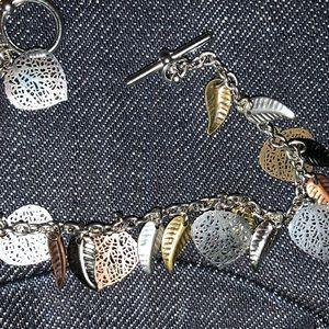 Super high end muting metal charm bracelet NWT